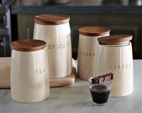 cream kitchen canisters set of four canisters labeled for quot coffee quot quot tea quot quot sugar quot and quot biscuits quot inr 3589 made of