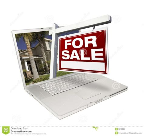 home for sale sign new home on laptop stock image