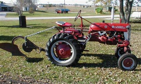 farmall cub tractor with 1 bottom pull plow for sale