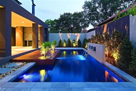 contemporary backyard pools with fountains gripping dark blue pool tiles with minimalist landscape ideas