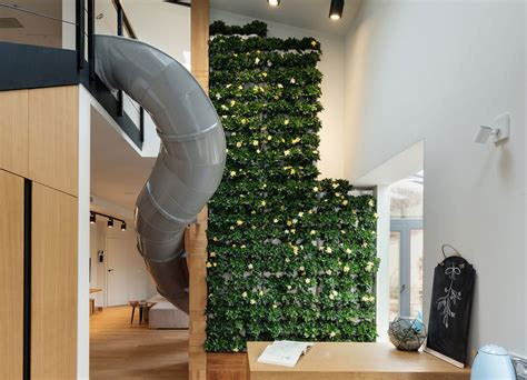 ki design funky slide cuts through this modern chic apartment in