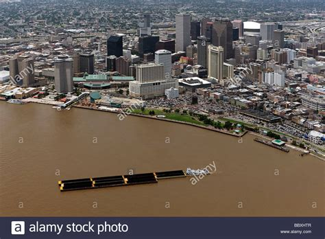 new orleans tugboat aerial view above tugboat pushing barge mississippi river