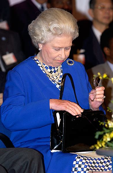 queens purse what s inside the queen s handbag and why is it so