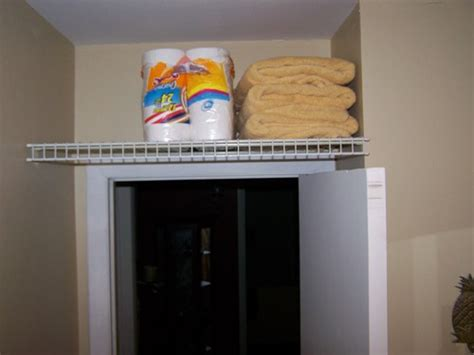 small tension rods for cabinets utilize extra storage space above your doors