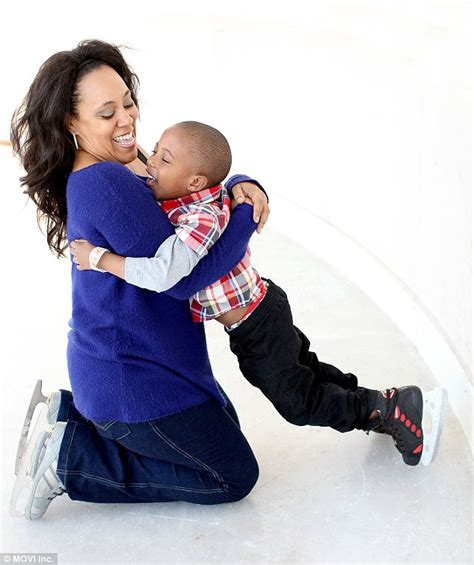 Into the arms of his mother alexsandra wright on an ice skating trip