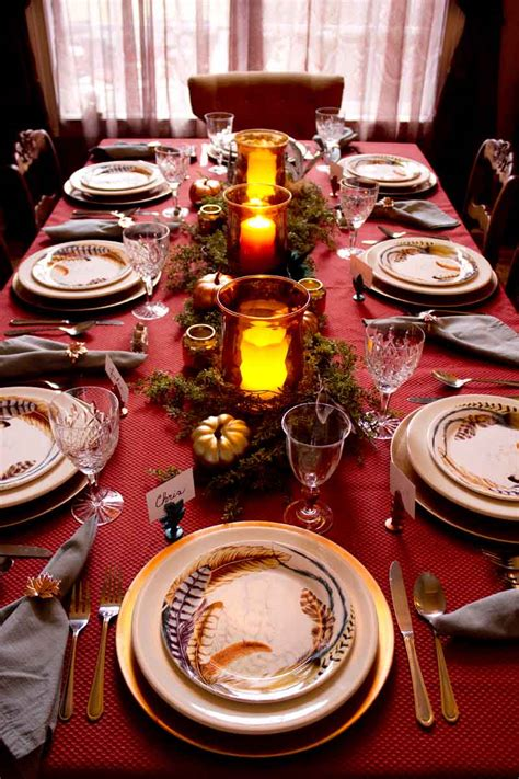 setting the table for feathers and metallics for a thanksgiving table setting