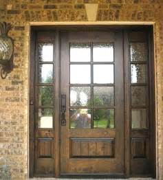 Wood front doors with glass man walking away from god carpet cleaning