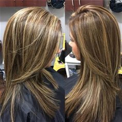 partial highlight foil placement dark brown hair with caramel highlights and midlength hair