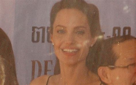 angelina jolie new tattoo on chest what s tat expert reveals secret meaning behind angelina