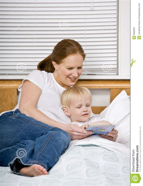mom son bed mother reading son a bedtime story in bed stock image