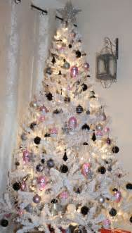 white christmas tree with pink black and silver ornaments
