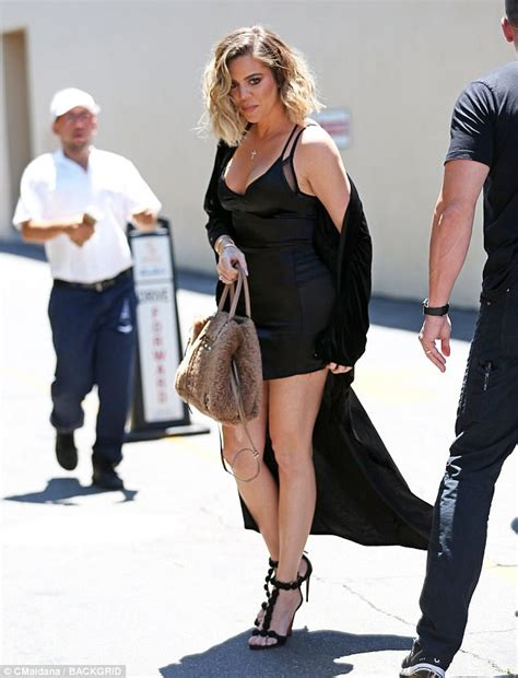 Khloe Black khloe nearly spills out of black minidress