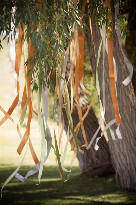 ceremony decor ideas hanging ribbons in wedding colors