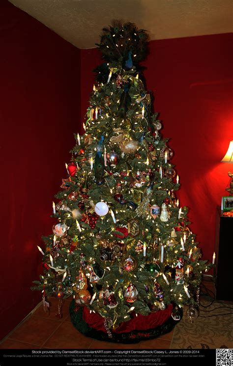 elaborately decorated christmas tree without gifts by