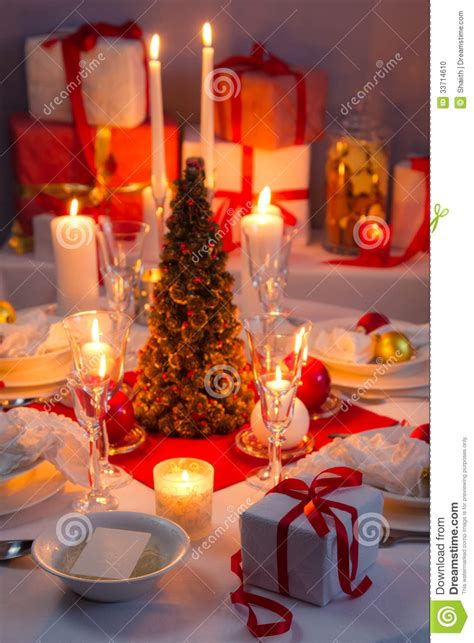 candlelight wafer and gifts on the christmas table stock