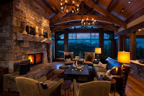 great room  awesome windows massive stone fireplace