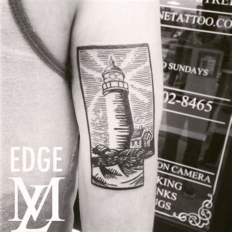 scrimshaw tattoo lighthouse in woodcut scrimshaw style