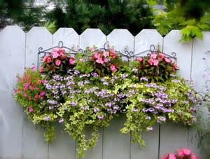 beautiful planter on a fence backyard