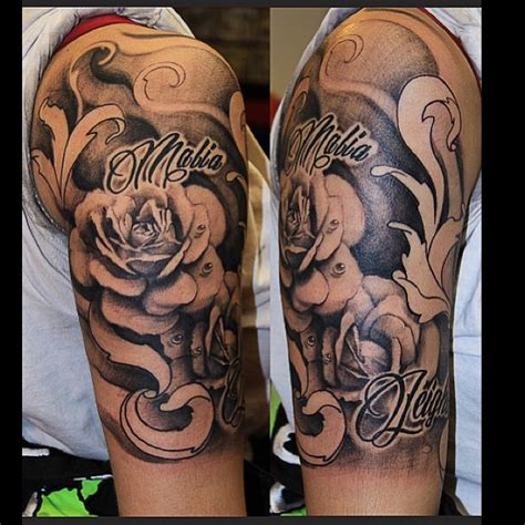 first session on this black amp grey roses half sleeve done