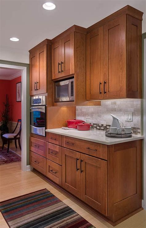 cherry cabinets with quartz countertops colors microwave in cabinetry under mounted lighting