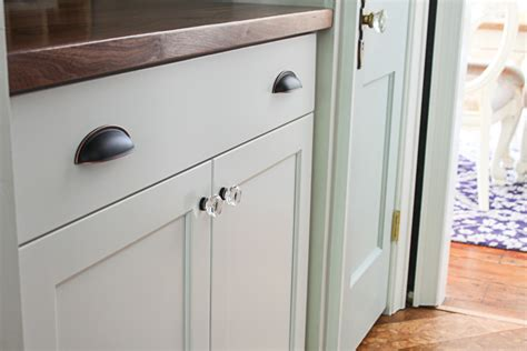 installing cabinet hardware the easy way domestically install cabinet handles the easy way pretty handy girl
