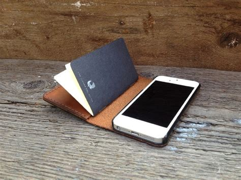 Handmade leather iphone wallet packs a paper notebook cult of mac