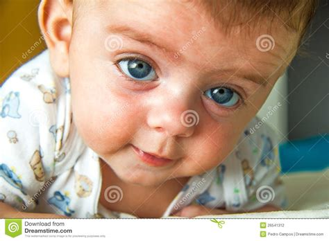 baby raising his head stock photography image 26541312
