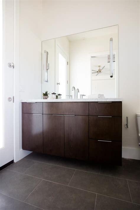 modern vanity  large floor tile  brown enrich white