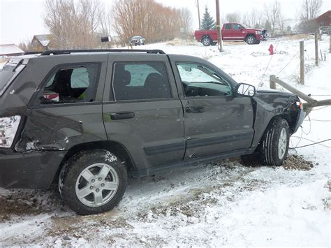 wrecked jeep grand slick roads cause crash with local