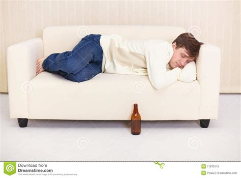 sleep on the sofa man sleep on sofa having got drunk beer royalty free stock