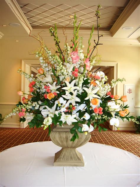 large floral arrangement in stone pedestal container the