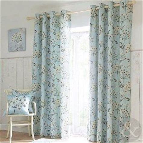 white and duck egg blue curtains summer floral eyelet curtains duck egg blue allium lined