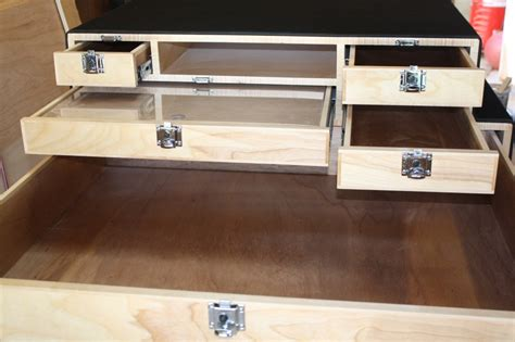 Open Drawer Command by Line X Coated Sports Utility Vehicle Cabinets