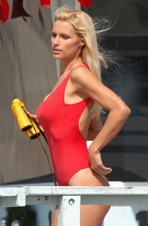 Puts On Baywatch Suit by Hunziker Is A Baywatch In Iconic