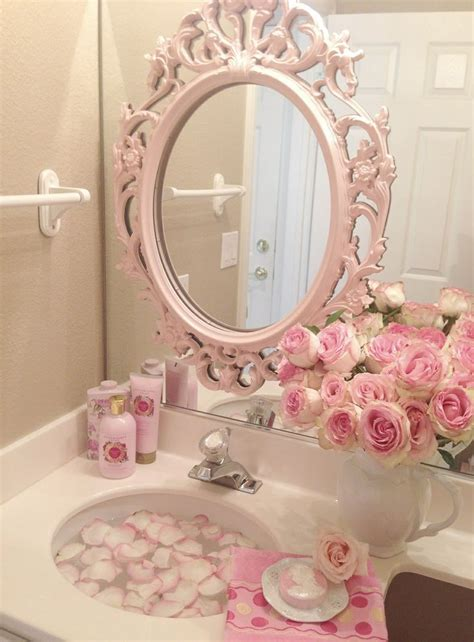 pink bathroom mirror looks like a frame has been attached to the large wall
