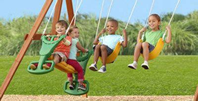 swing features stonefield lodge climbing frame with curved slide and