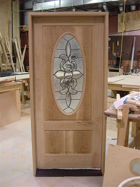 made white oak front entrance door with oval leaded glass by the woodsmith llc