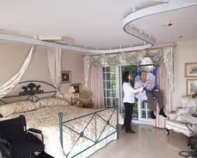 Arjo Huntleigh ceiling transfer lift devices   Bridgeway Independent Living Designs, LLC