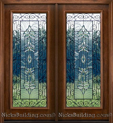 Wrought Iron Patio Doors Mahogany Patio Doors With Beveled Glass And Wrought Iron Detailing