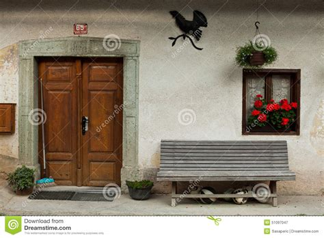 alp front bench home door entrance in slovenian alpine village stock photo