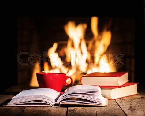 Fireplace Book by Cup Of Coffee Or Tea And Books On Wooden Table