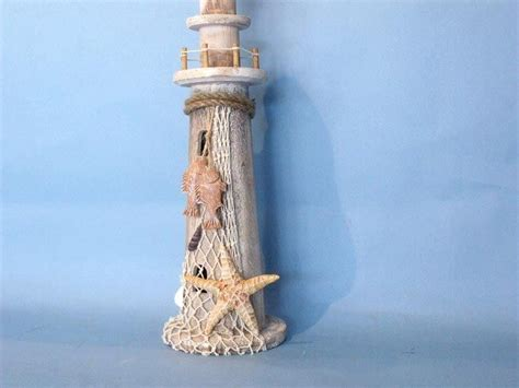 Lighthouse Decor by Wooden Lighthouse Shells Starfish And Net 16 Quot Decorative
