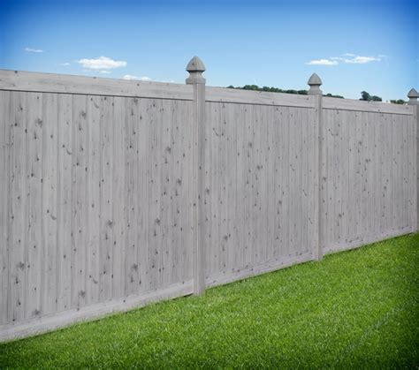Gray wood grain pvc vinyl privacy fence by illusions vinyl fence traditional landscape by