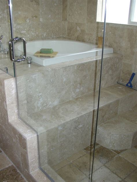 tiling side of bathtub now this is a cool idea glass wall shower on one side and