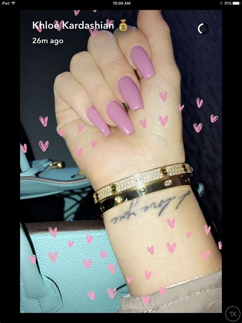 khloe kardashian tattoo wrist shares smooching snap with kanye west