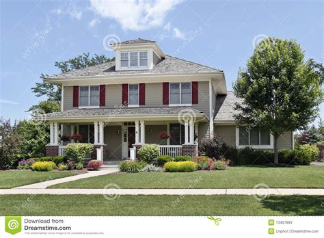 Home Plans With Porch by Suburban Home With Red Shutters Stock Image Image Of