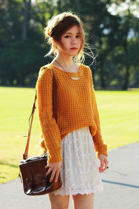 picture   mustard sweater  white lace skirt