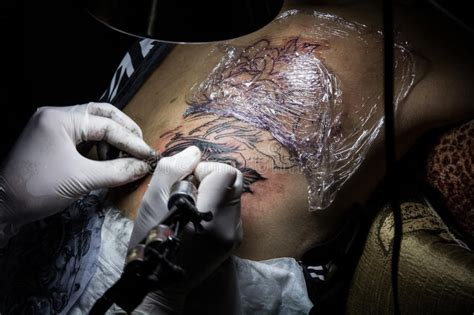 process of tattoo design tattooer showing process of making a tattoo tattoo design
