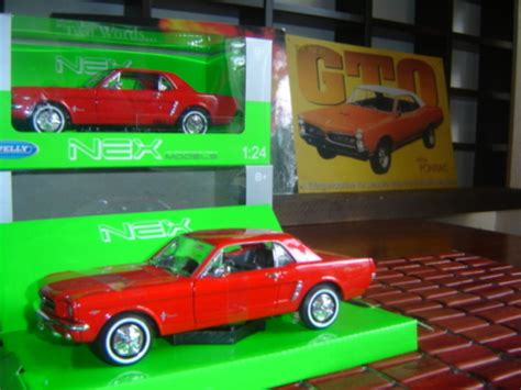 Diecast Miniatur Mobil Nex Welly 1 24 New Mini Hatch Kuning Grosir models ford mustang coupe 64 v8 die cast scale 1 24 welly nex new in d play gteed in stock