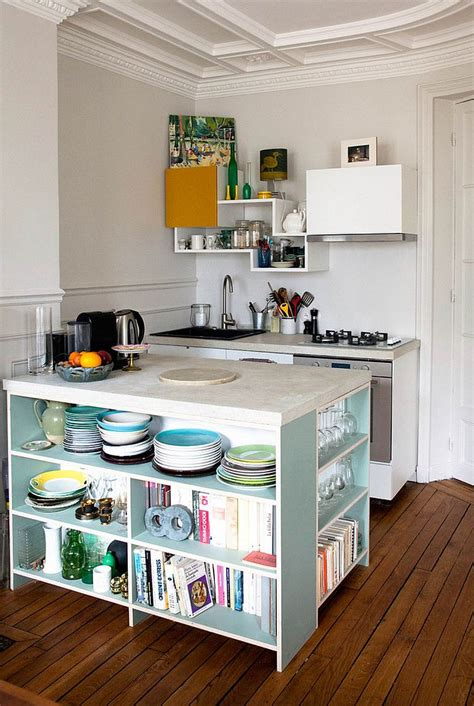 tiny contemporary kitchen with island that features open